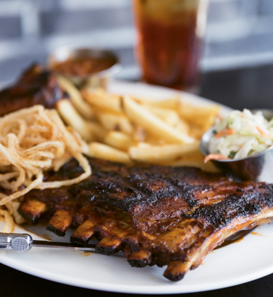Rack 'Em Up: Hard Rock's Smokehouse menu offers this Hickory Smoked Barbecue Combo, a hearty platter of ribs, pulled pork and chicken. And it comes with sides of crispy matchstick onions, cowboy beans, seasoned fries and a citrus-based slaw.
