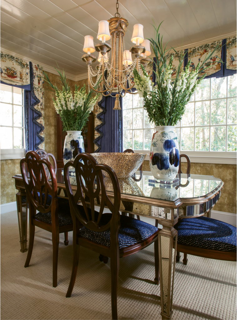 What to do with an upstairs porch that you never really use? Gore turned his into a small but stunning formal dining room featuring a mirrored table.