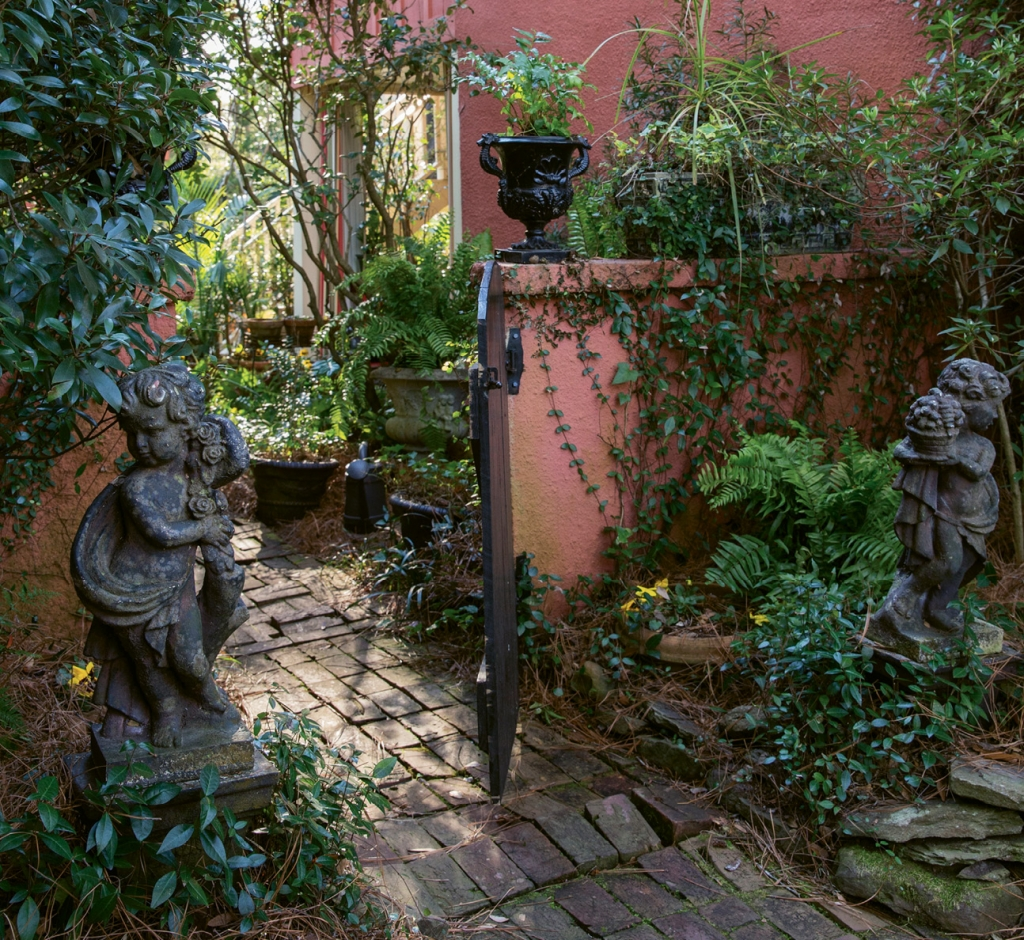 Just follow this brick pathway into the enchanted garden. As the perfectly staged promenade of plants and statuary promises, you won't be disappointed.