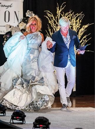 "Diana Van Etten modeling ""The Gift"" with designer Jimbo Newton. Winner of Haute Couture."