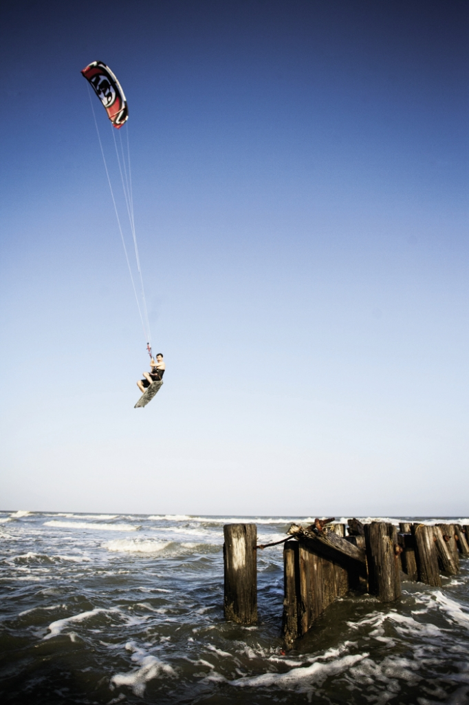 """""""Big air,"""" common to many board sports, is the goal of most kiteboarders and refers to the height and length of time spent off the ground, or in this case, off the water."""