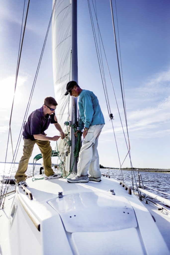 Captain Jason Cox and Harold Rohrback make the halyard fast on its cleat