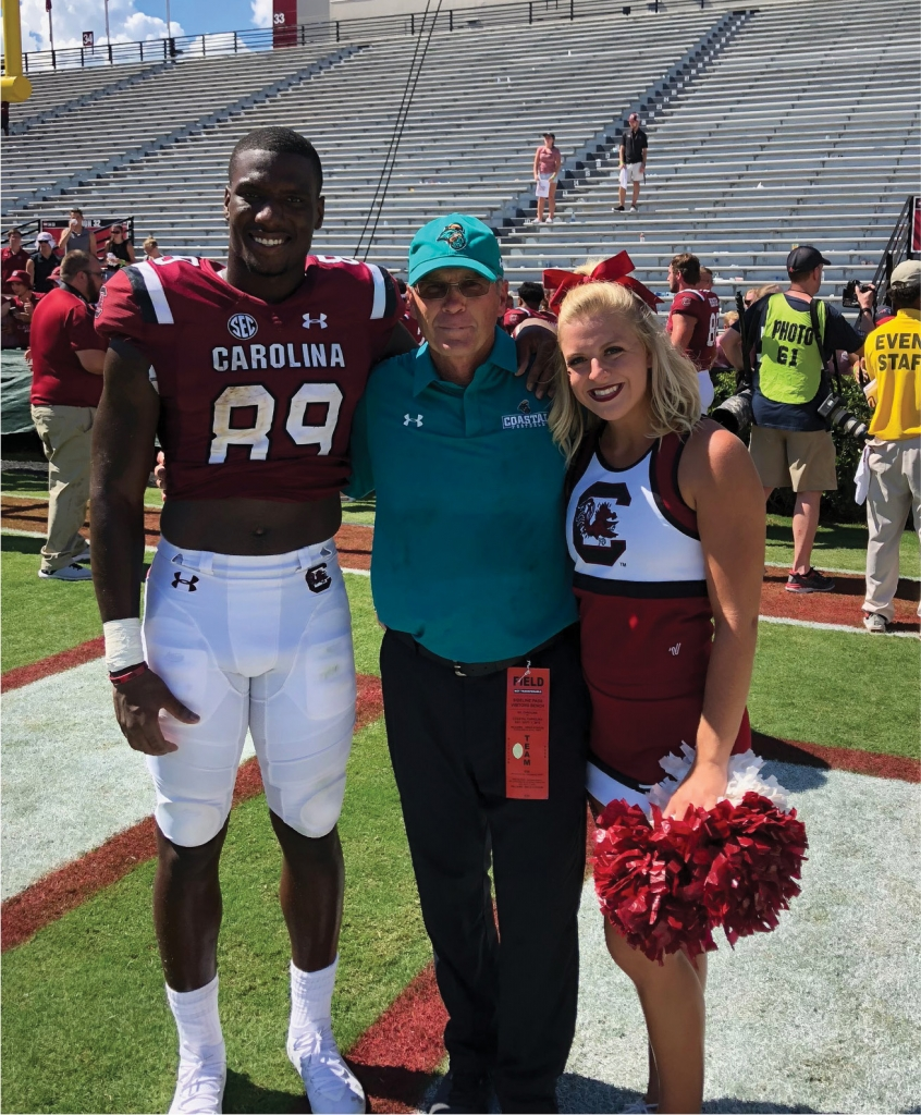 Bryan Edwards with Chuck Jordan and Allie Graham, a USC cheerleader and fellow Conway High School graduate, at a USC/CCU game