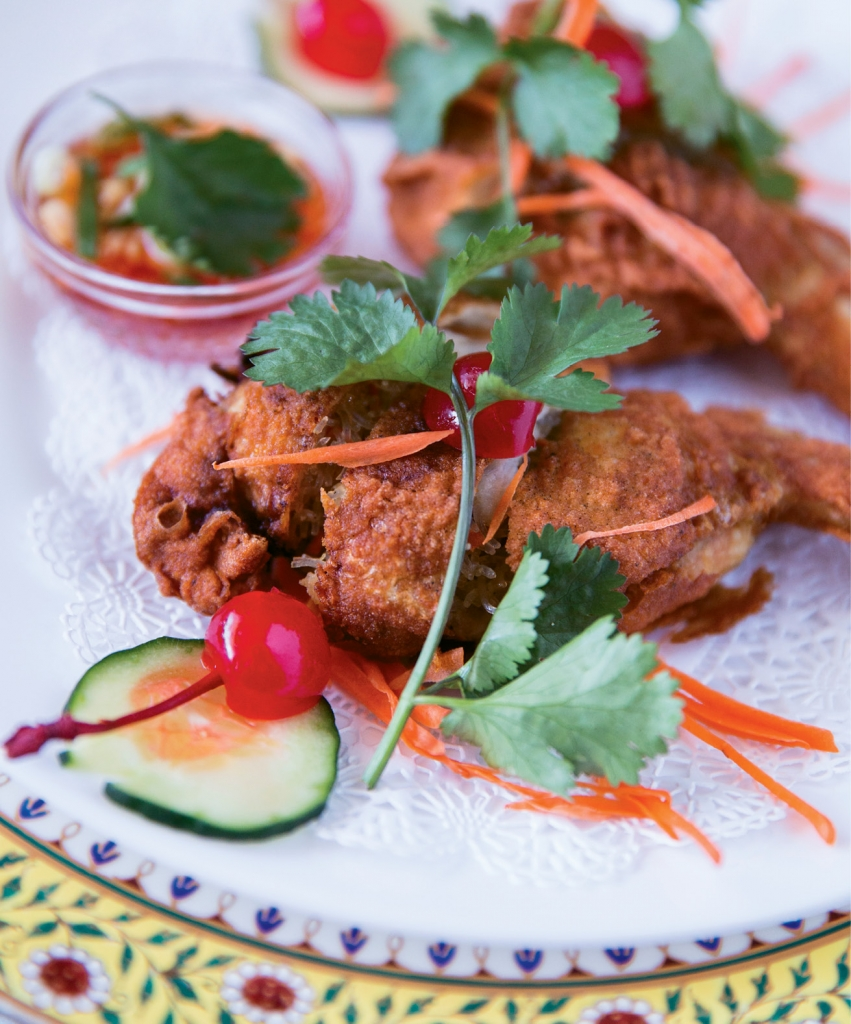"Ped Tarmarin (aka: Crispy Duck) is a house favorite at Blue Elephant and as the menu suggests, ""A Must Try."""
