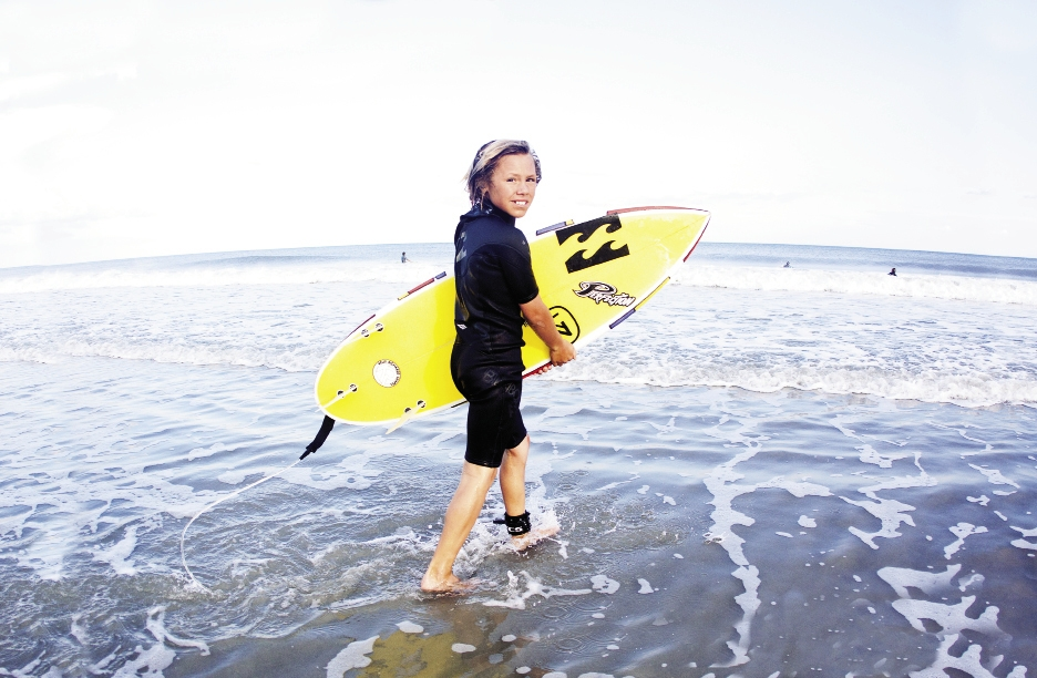 Eleven-year-old Micha Cantor, one of the youngest and winningest kids on the local team, surfs year-round here and abroad.