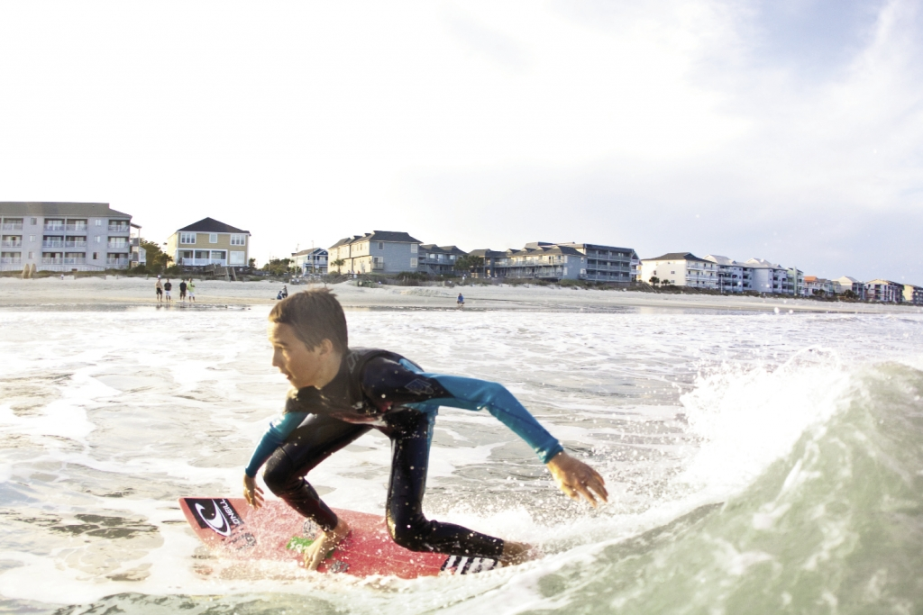 Fifteen-year-old Addison Miles prepares for a trick in the surf at 13th Avenue South in Surfside Beach.
