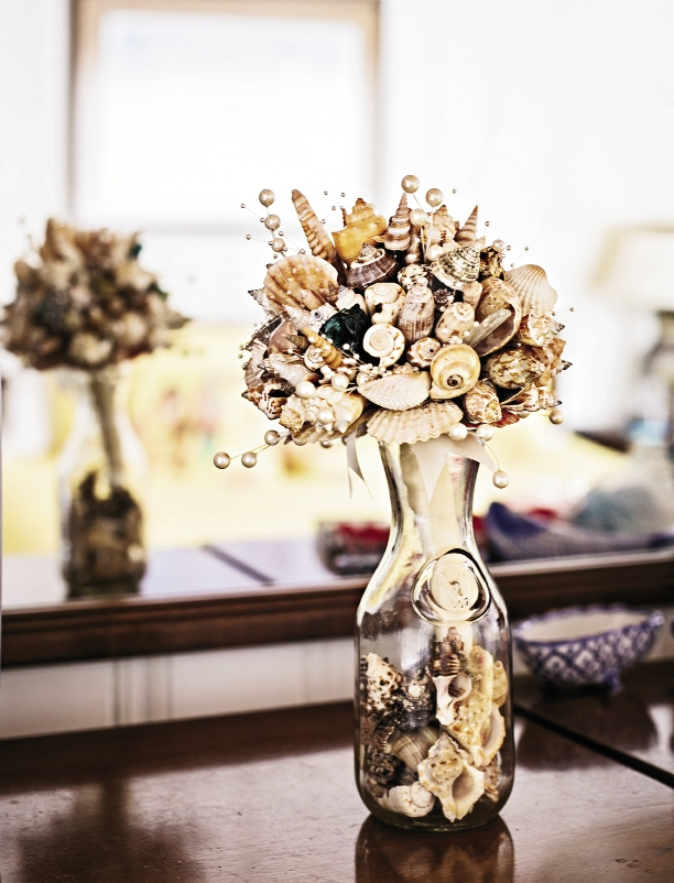 Jessie and her bridesmaids collected shells from the beach to use in her unique bouquet created by her mother and her mother's friend.