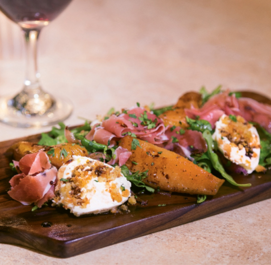Bring On The Burrata: For something delightfully different, the burrata board is a medley of creamy medallions of cheese, prosciutto, pecans, carmelized pears and arugula.