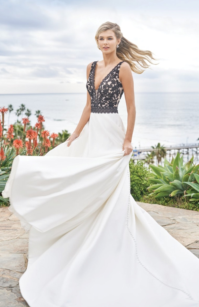 Jasmine - This romantic Italian satin and embroidered lace A-line gown features a V-neckline with a beautiful black and ivory lace bodice. The semi-cathedral train has buttons all the way down.  Amanda's Collection; $1,185