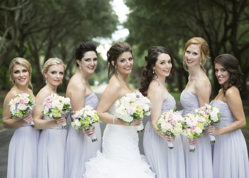 Silver Belles: Brittney chose a pretty palette of gold and silver throughout her wedding party and table settings.