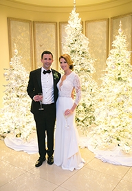 Deck the Halls: Leslie and Bryan embraced the festive decor already in place at their wedding venues that would brighten their world on such a special day.