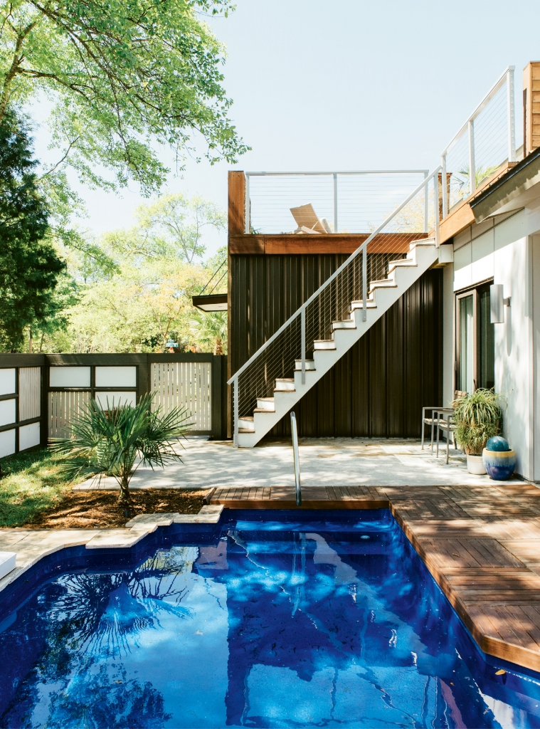 Fronting a busy Myrtle Beach street, the second floor patio and main floor outdoor space emanate a Zen-like vibe. Materials used in the hardscape and fencing marry mid-century modern with Japanese garden.