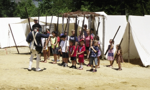 Kids participate in a musket drill at Yorktown Victory Center.