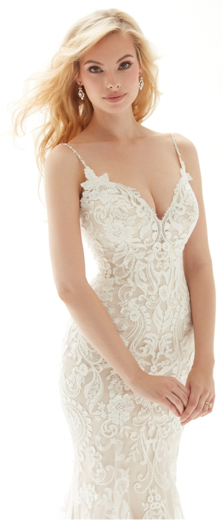 Madison James by Allure - This fit and flare gown features an intricately designed lace all over, delicate beaded straps, a low V-back and button detail to the bottom of the train. Accented by simple scalloping on the bottom, the dress comes in multiple colors. It is pictured in champagne/ivory.  Fancy Frocks; $1,273