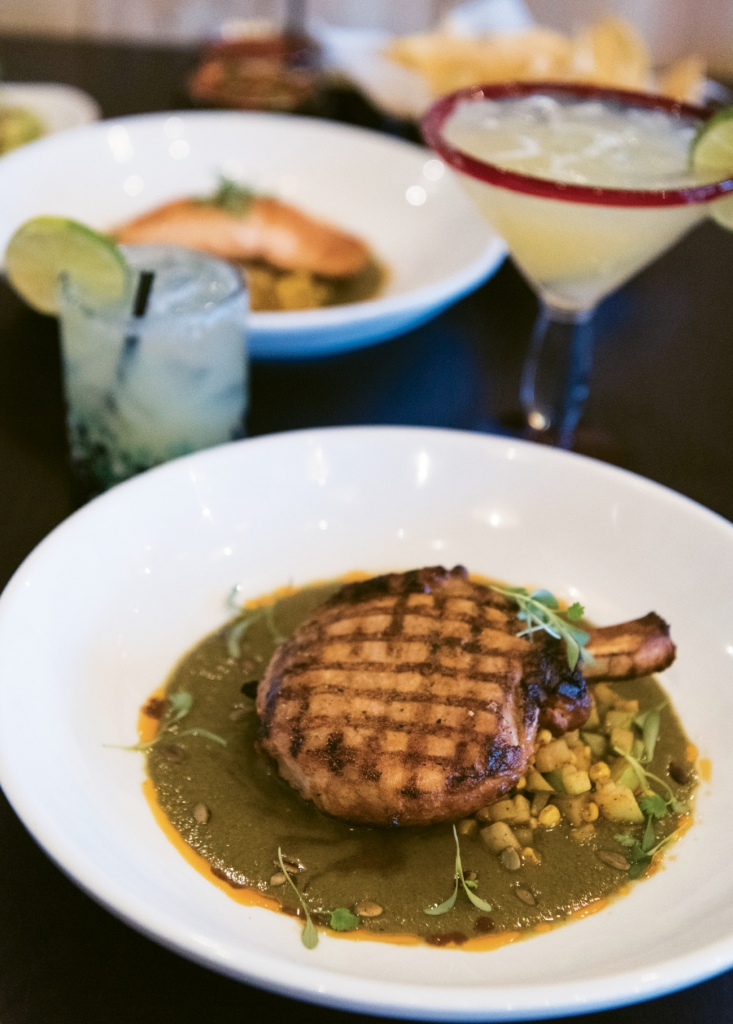 Fiesta of a Feast: Chuleta de Cerdo en Mole Verde features a grilled bone-in pork chop marinated in a chile ancho and guajillo adobo.