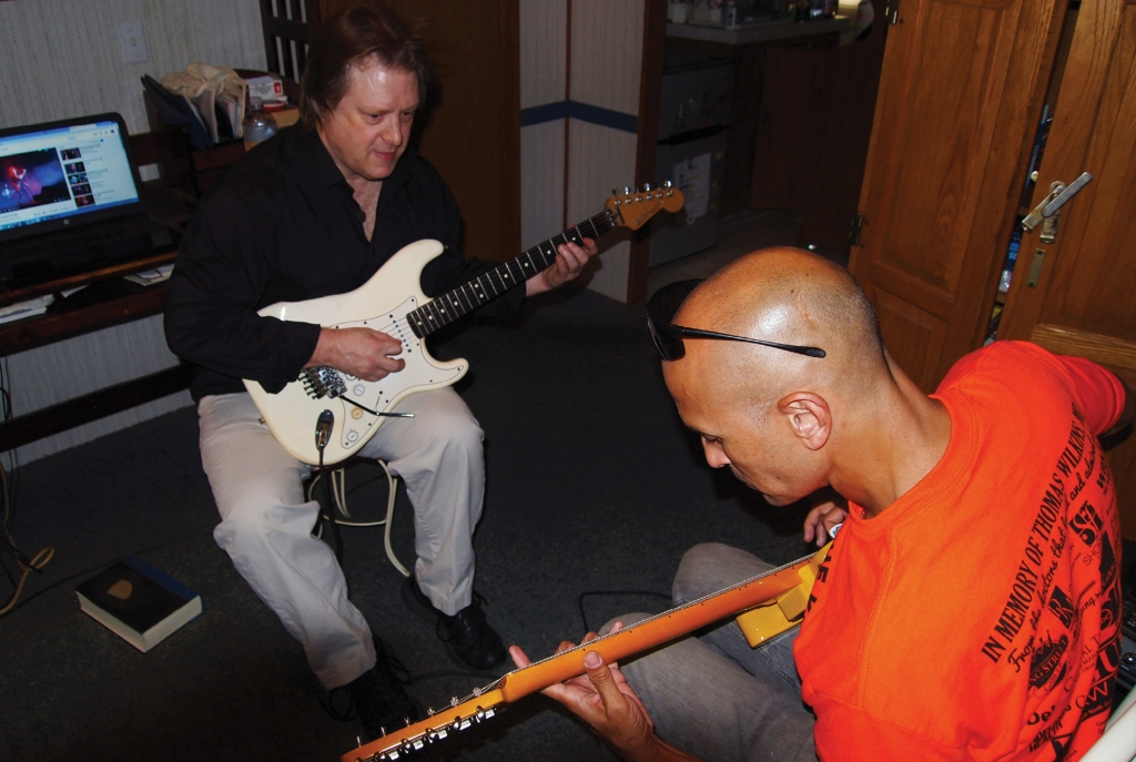 "Ready to Rock: At his home studio in Myrtle Beach, performer and instructor Chris Lanier teaches local radio personality Jerry ""Kosmo"" Sandwick the ins and outs of rocking out."