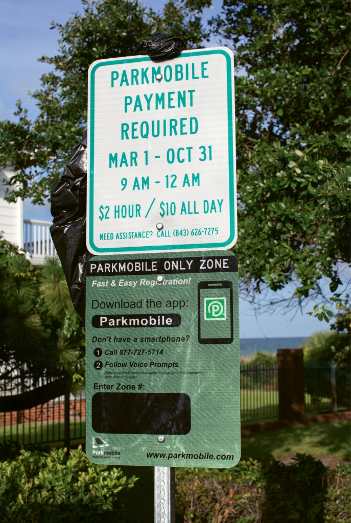 New signs provide instructions for setting up a payment method through an individual cell phone.