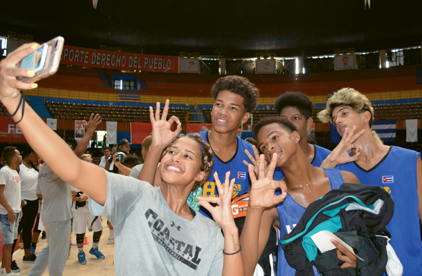 Kaylin West takes a selfie with several of the youth basketball clinic participants.