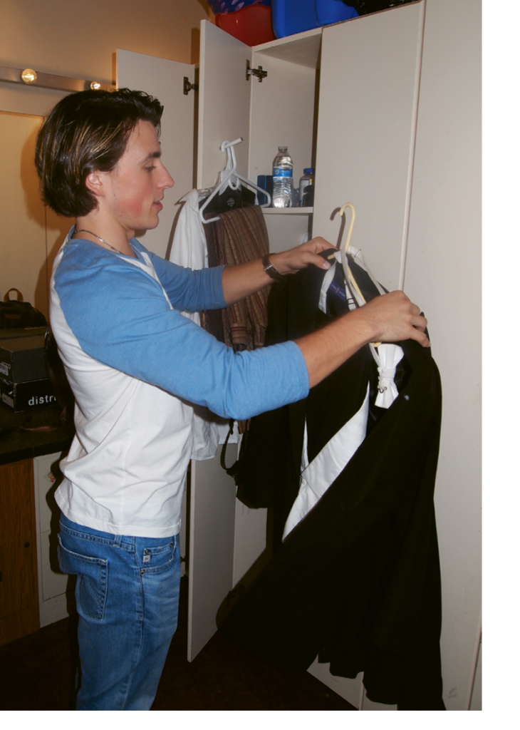 Zak double checks his backstage closet in preparation for multiple costume changes.