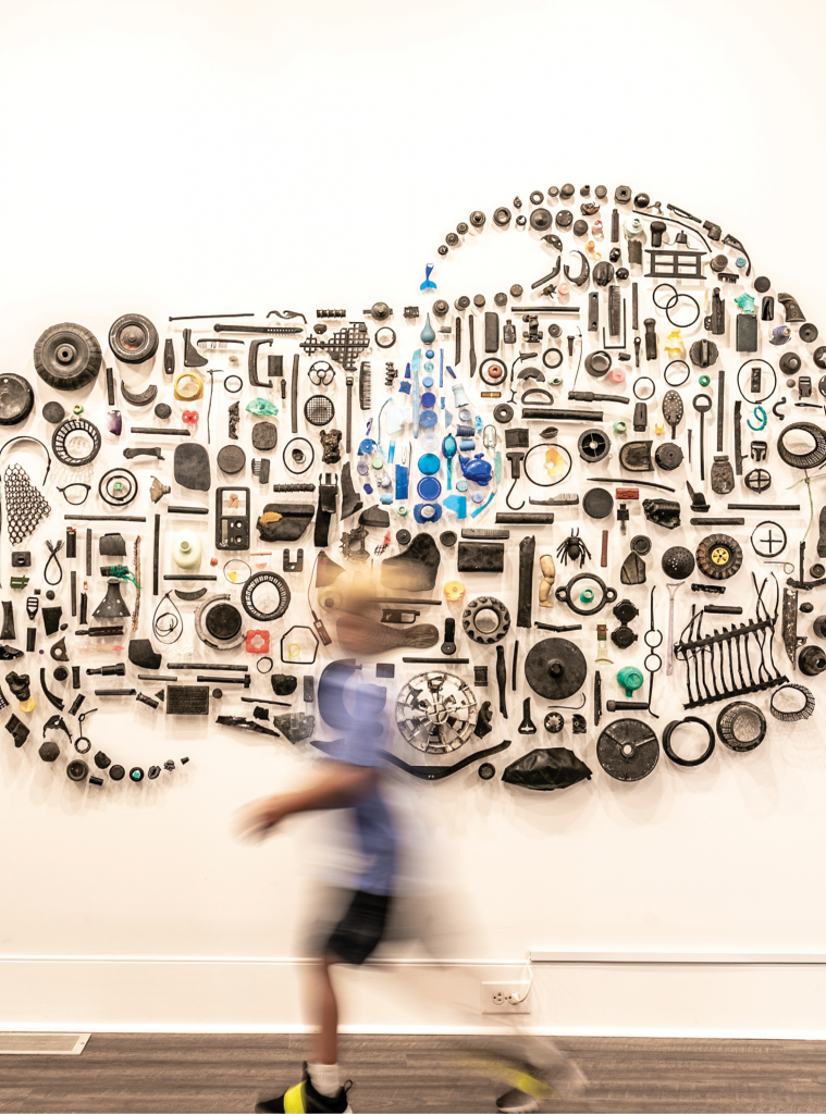 A visitor passes by Swerve by artist Pamela Longobardi, one of the exhibits from Can't You Sea? Ocean Plastic ARTifacts, from the summer of 2019, when artists used recycled/reclaimed plastic trash from the ocean and beaches.