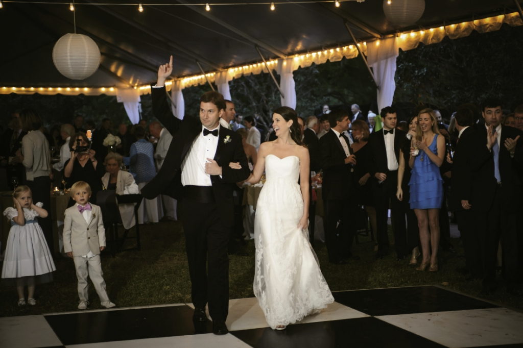 Stand By Me: It was the title of their first dance and a testament to this couple's love and devotion as they departed the tented reception as husband and wife under the stars and canopy of live oaks.