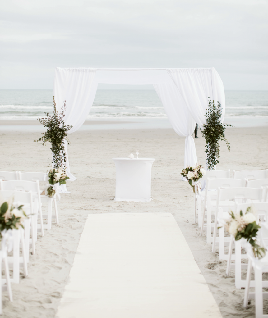 The pair wrote their own vows for their ceremony, held on the beach just before sunset. It was officiated by Drew's sister, while his brother shared several Jewish traditions to incorporate.