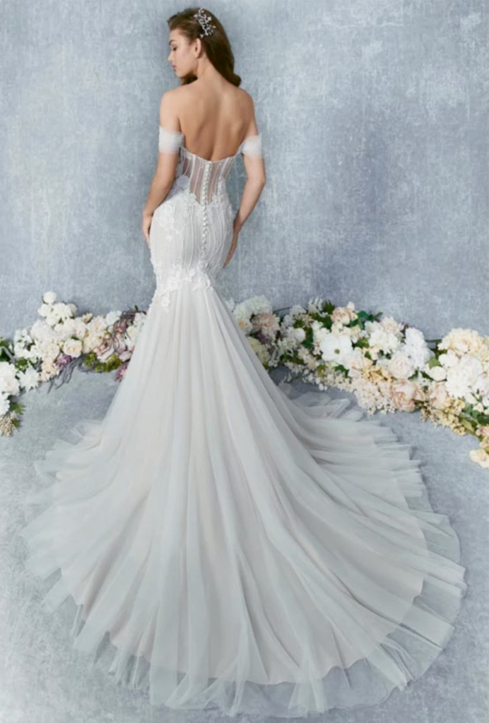 KENNETH WINSTON This sexy off-shoulder gown features a soft tulle overlay. The exposed boning is the perfect backdrop for buttons along the back zipper. Dimensional lace is incorporated throughout the bodice and skirt.  Amanda's Collection; $1,540