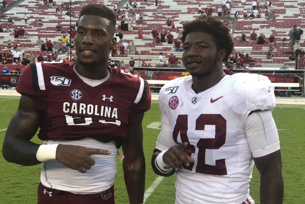 Bryan Edwards, left, with Alabama linebacker Jaylen Moody, a former teammate at Conway High School