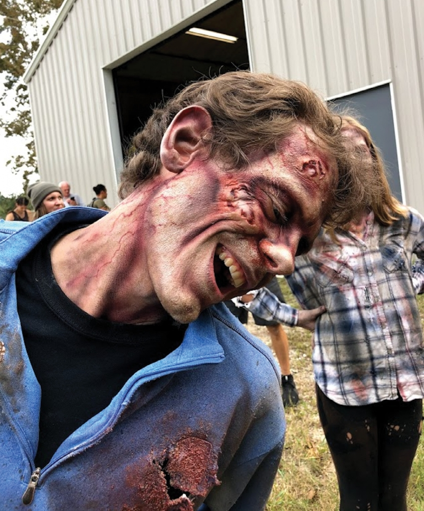 Benjamin Higgins as a zombie in Thirst of the Dead.