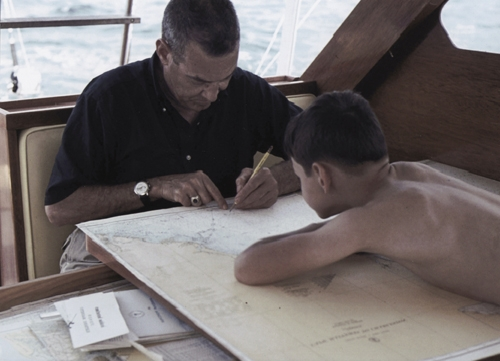 Dinks and son, Kenny, making notations on the NOAA chart. Dinks kept meticulous records about the areas they fished: bottom structure, depths, weed lines, fish sightings and hook-ups, as well as fish landed.