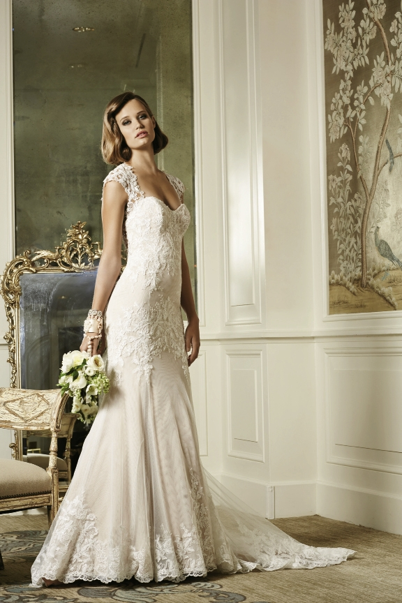 Wtoo by watters The Julienne is a splendidly beaded, English net and lace fit and flare gown accented with hand-placed lace motifs that cascade down the silhouette. Features keyhole back, sleeveless neckline and striking scalloped hem. The Little White Dress, $1,550