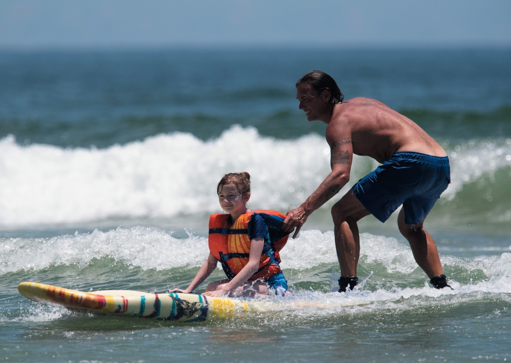 Luke Sharp helps Samantha Perryman at a recent Wheel to Surf event.