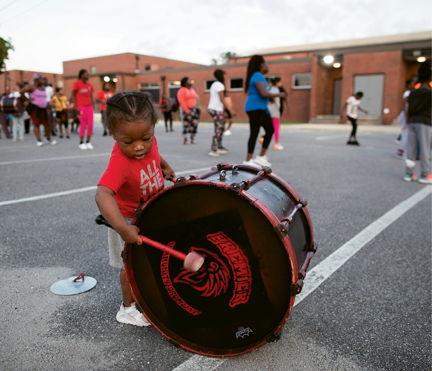 The youngest member, 2-year-old Zion Giles, who plays cymbals (but he likes beating the drums, too).