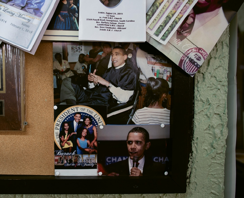 Friendly Barbershop keeps memorabilia on its walls, including this pic of Barack Obama getting a haircut in Marion County during his first presidential bid.