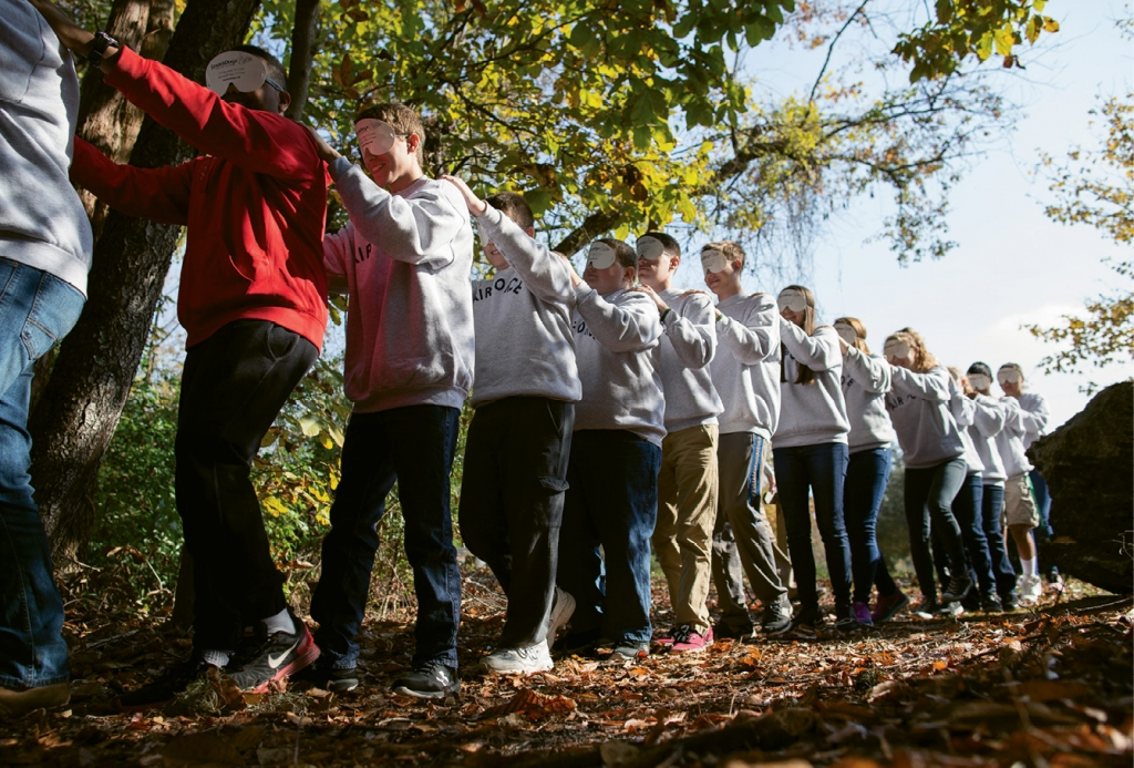 "The experience at Playcard Environmental Education Center is as much about team-building as it is nature. Socastee High School ROTC cadets take a ""blindfold walk"" through the woods"