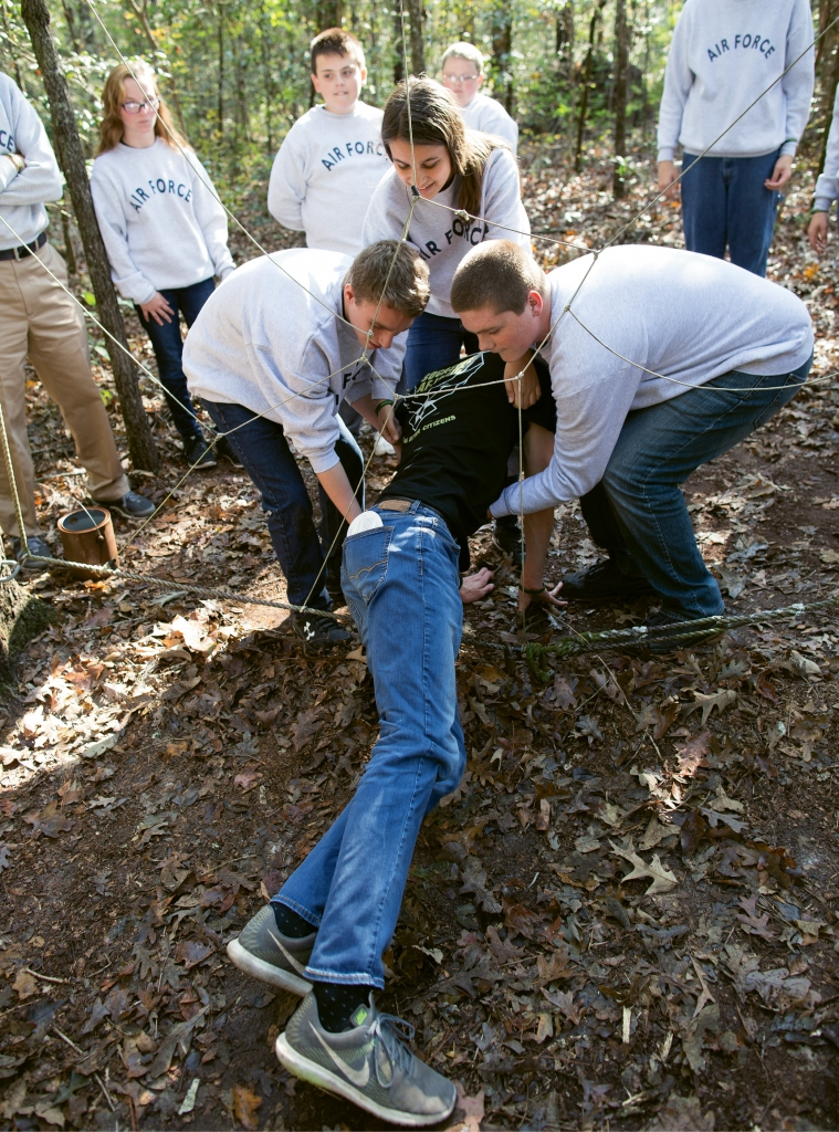"""The low ropes challenge """"Spider Web"""" forces students to work together physically in order to get each other through every hole without touching the ropes. The intellectual challenge? Once they use a hole, it gets """"closed."""""""