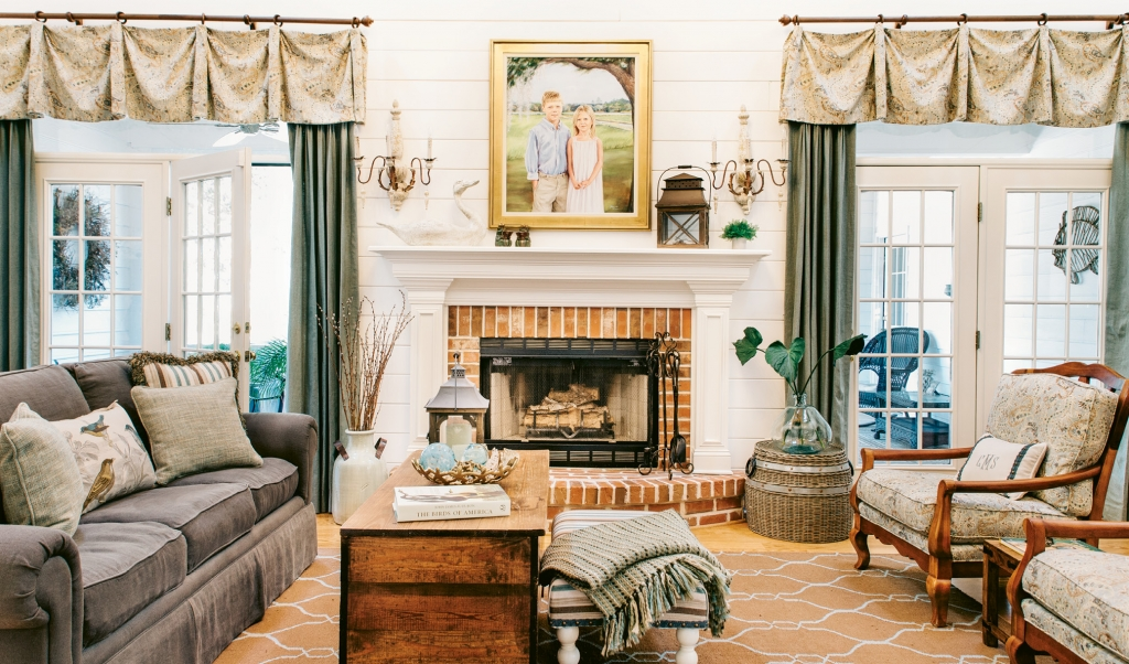 The center-stage fireplace wall in the main family room needed to be reworked, so out came the hearth's dark green tile surround. The walls got a creamy shiplap covering and the whole space was lightened and brightened.