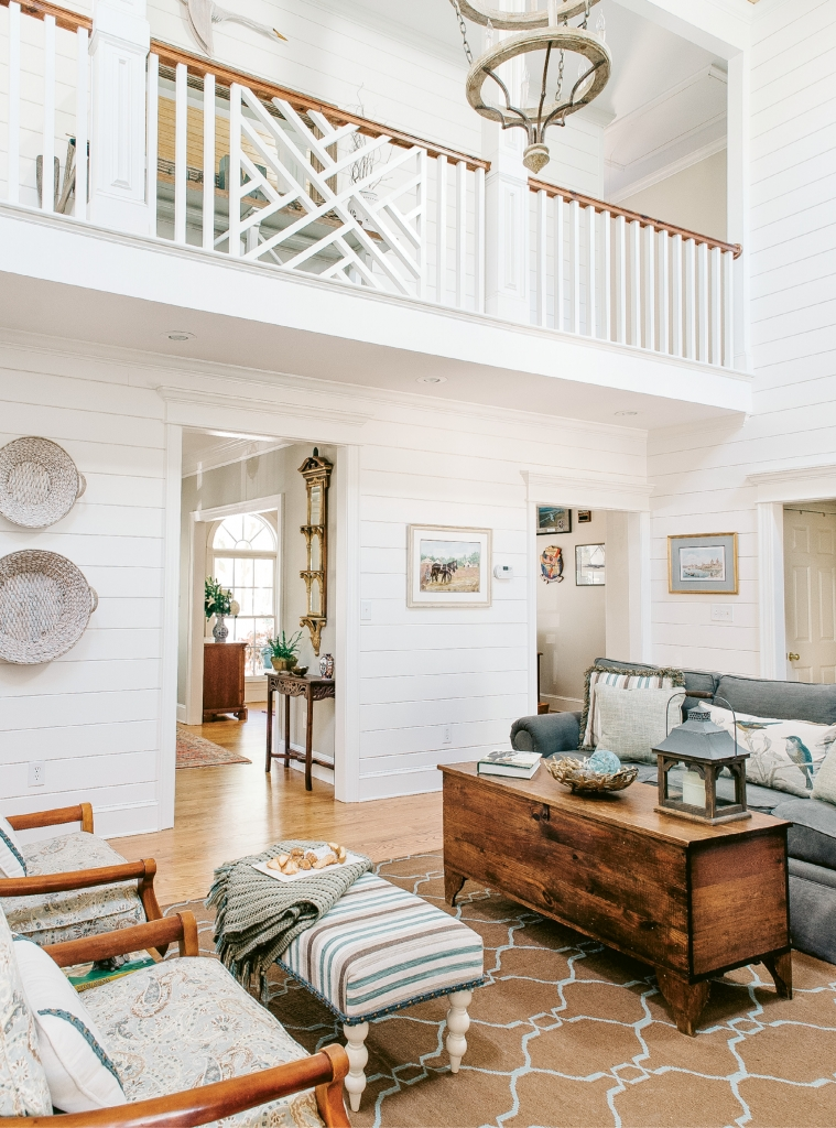 To create a stylish sound barrier to the upstairs loft media room, a shiplap gallery wall was built. The railings were redesigned in a Chippendale pattern, lending another layer of visual interest to the home.