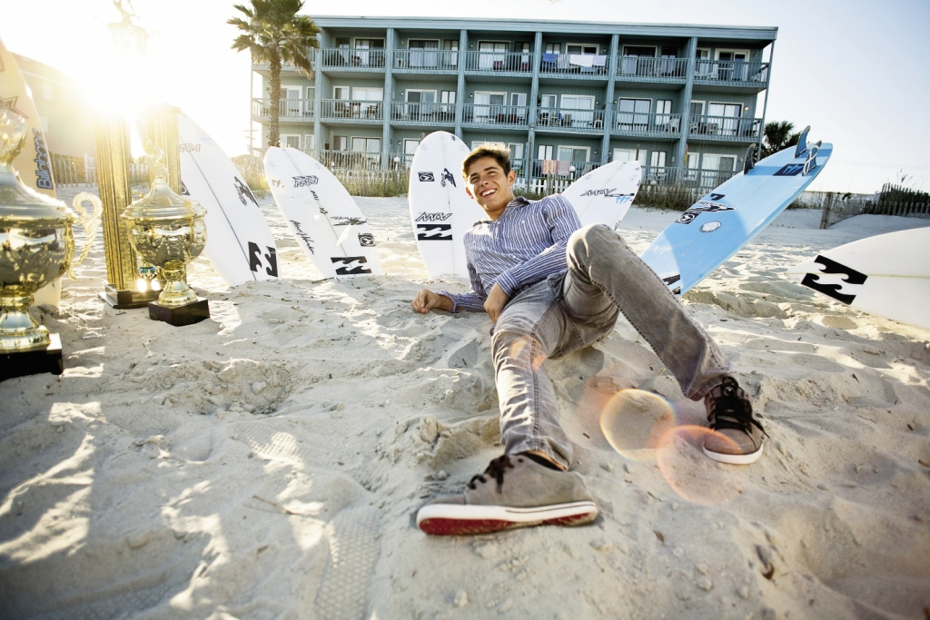 Relaxing near Garden City Beach Pier with a few of his trophies and a few of his surfboards, national champ Cam Richards is enjoying a life most teens only dream about.