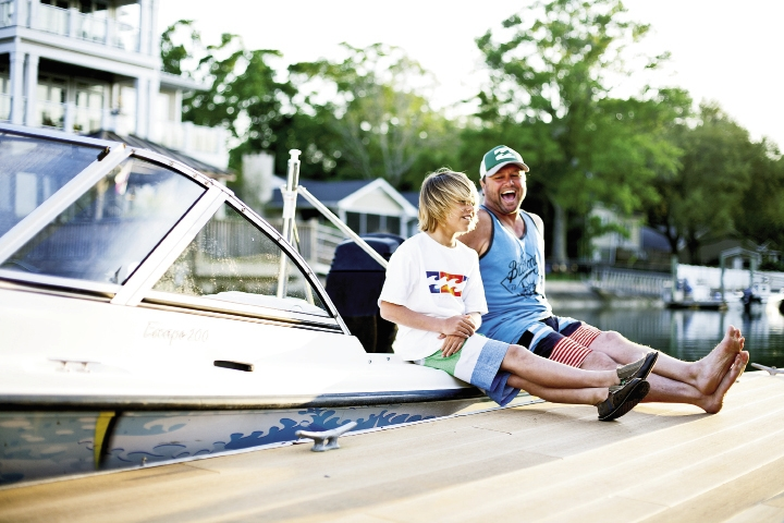 Local surf champ Micha Cantor relaxes with his dad, Stoney Cantor, on the family's boat in Murrells Inlet.