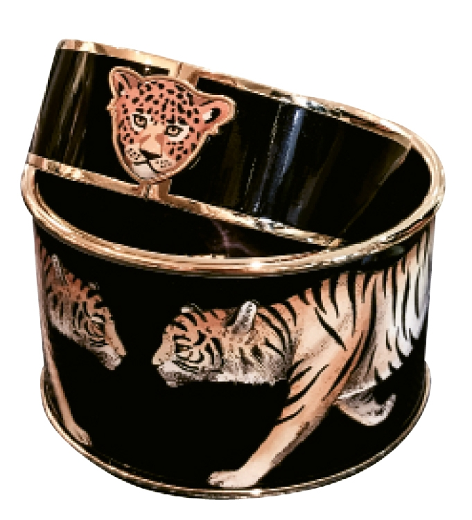 Be the eye of the tiger in these fierce bangles from Eleanor Pitts.