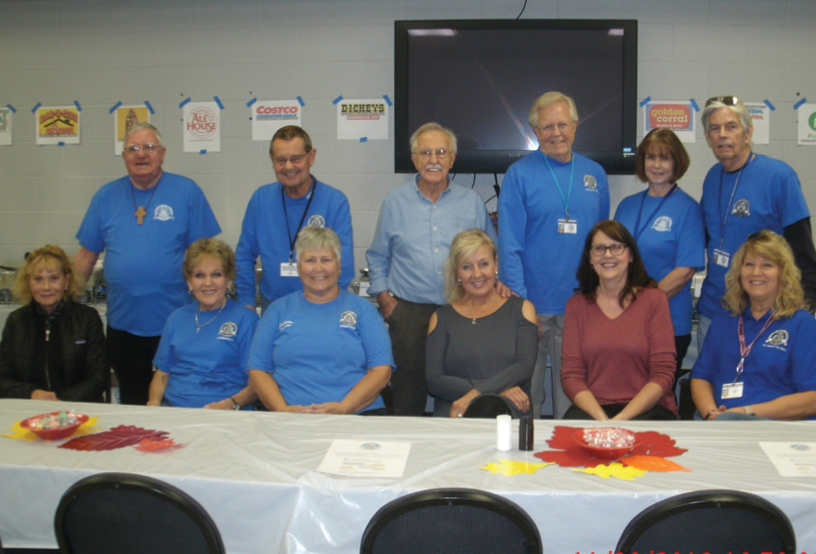 Prescop, third from left front row, poses with  volunteers who served the Thanksgiving feasts to Myrtle Beach Police Department personnel in 2018.