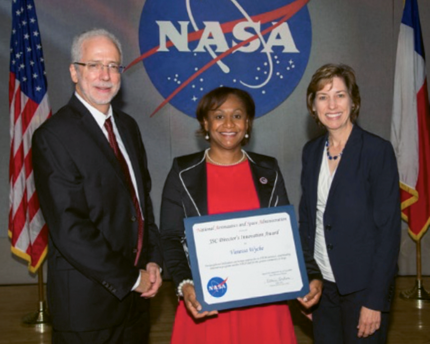 Wyche receives a Director's Innovation Award, presented by Mark Geyer, JSC's Deputy Center Director, and Dr. Ellen Ochoa, JSC's Center Director