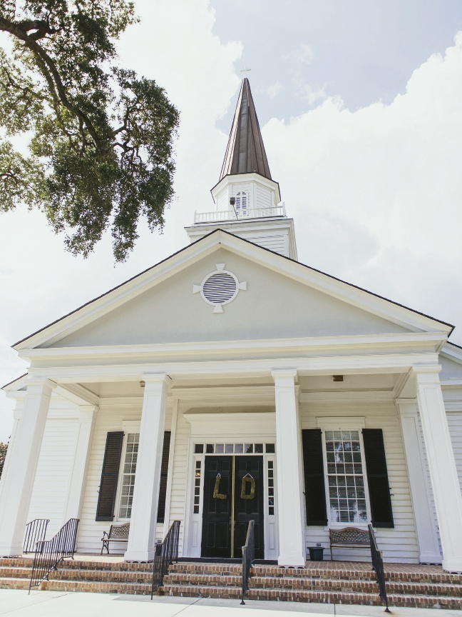 The ceremony was held at Belin United Methodist Church in Murrells Inlet. The doors to the church were adorned with a Spanish Moss monogram designed by Greenskeeper Florist.