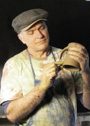 """Potter Michael Mahan of From the Ground Up applies ancient and modern firing techniques to create his signature pieces depicting bare trees. """"The ancient Celts loved trees. Their alphabet consisted of twenty symbols, each representing a sacred tree. In turn, each tree represented a feeling, attribute or essence."""""""