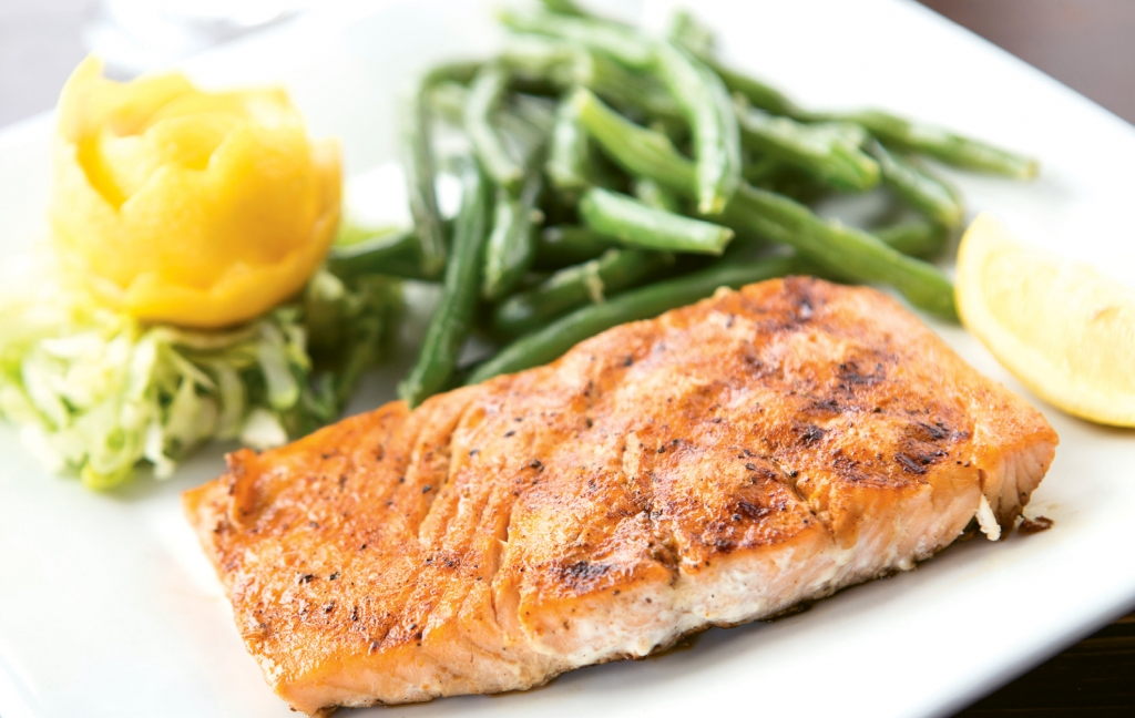 The fire-grilled salmon is simply perfect and is served with an outstanding dill sauce at Pier 14 Restaurant.