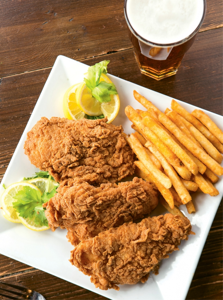 A classic plate of beer-battered fish and chips at Pier 14 comes with a house-made coleslaw and zesty tartar sauce.