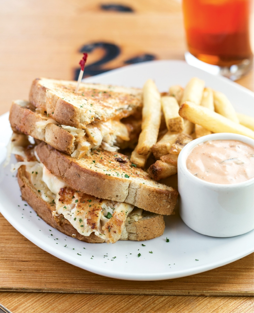 Behold the Georgetown Grouper Reuben—a fresh pan-seared filet pressed between thick slices of grilled rye with Thousand Island dressing, sauerkraut and Swiss cheese from Pier House Restaurant at 2nd Avenue.