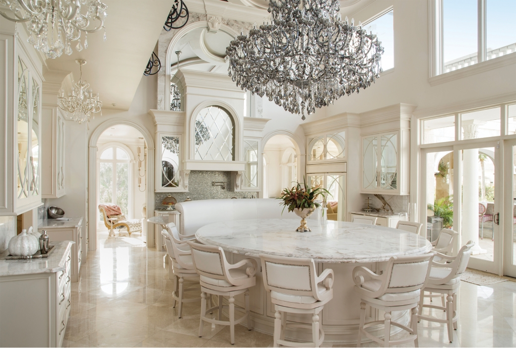 Kitchen Jewelry: Like a well-accessorized red carpet poser, this kitchen in Crystal and Gary Langston's home is paparazzi-worthy with Swarovski hardware, a ginormous Italian crystal chandelier and the luxurious gleam of imported marble.
