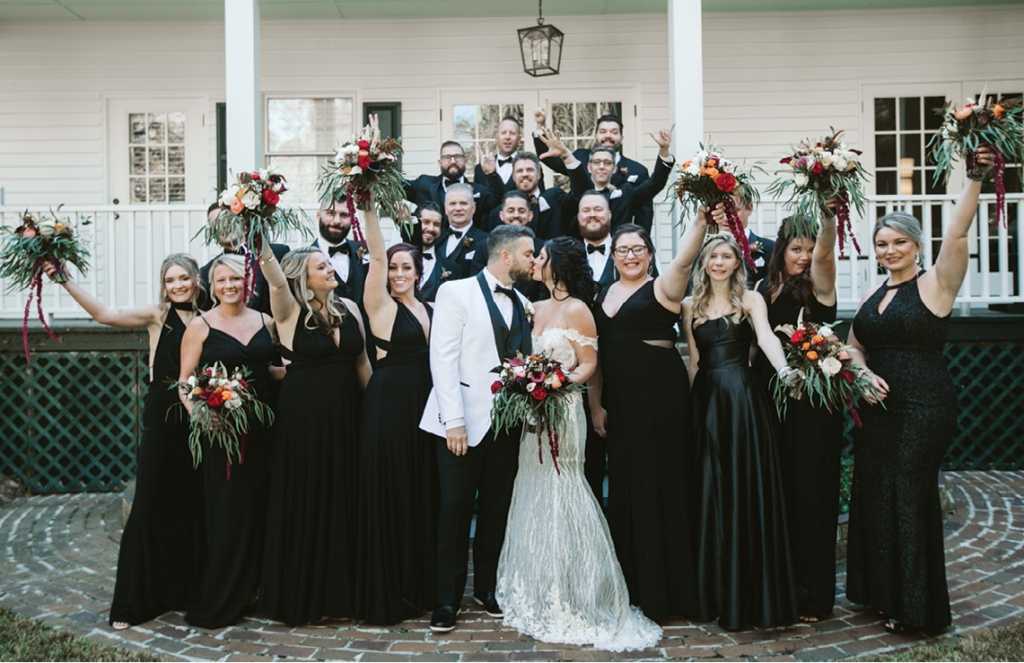 The groom wore a custom white coat, with the bridal party in black.